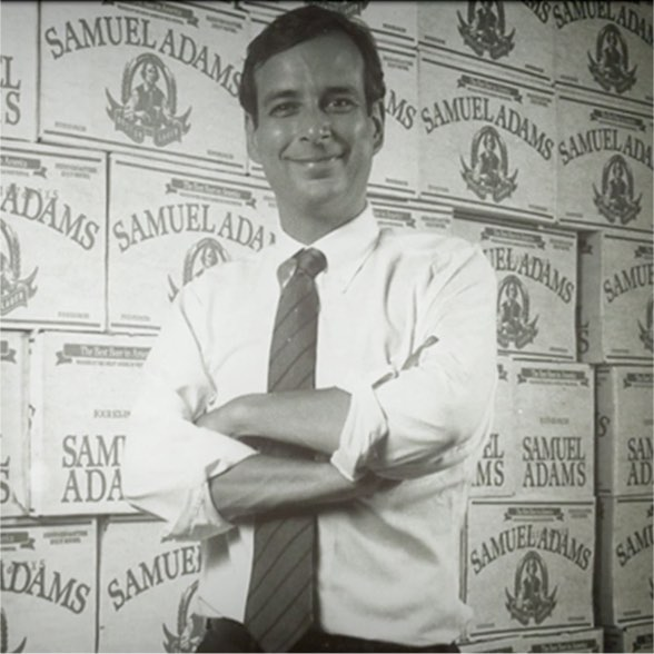 Young Jim Koch poses with cases of Sam Adams