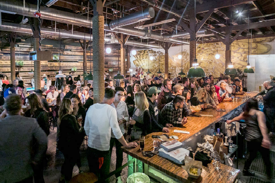 people congregating at craft brewery